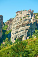 Monastery on the top of tall cliff in Meteora