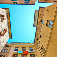 Courtyard with drying laundry in Genoa