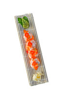 Salmon sashimi roll with sauce. white isolated background