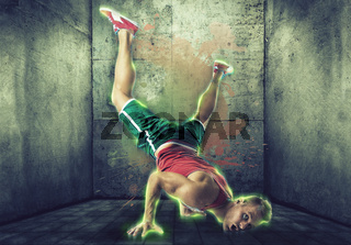 Young blond man in neon effect dancing breakdance