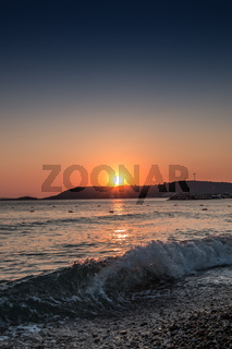 Sunset and waves at the beach of the Turkish sea