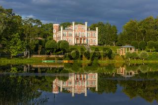 Birini palace and mirror reflection in Birinyu lake, Latvia