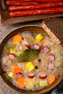 rustic sauerkraut soup with bacon and sausage