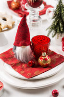 Christmas And New Year Holiday Table Setting. Celebration. Place setting for Christmas Dinner. Holiday Decorations. Decor.