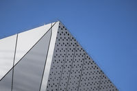 Architecture detail of a modern building with a blue sky on background. Facade design.