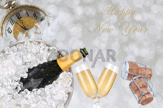 Happy New Year collage with Champagne bucket, flutes, corks, and watch set to almost midnight.