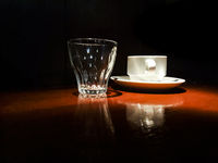 Coffe and Glass Cups Over Table