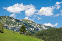 Paraglider flying in the mountains