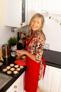 Woman cooking fruit pies in the home