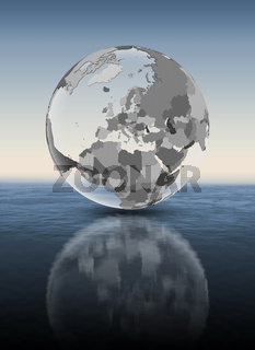 Slovenia on translucent globe above water