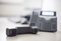 Classical black telephone in the office, customer support and telesale