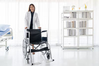 Doctor hold Wheelchair
