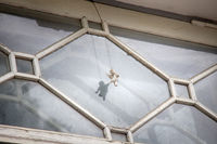 tiny figure of angel is always in window of tenant of apartment