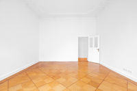 empty room with wooden parquet floor refurbished apartment