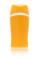 A blank orange sun cream bottle isolated on white background with fading reflection