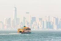 Staten Island Ferry and Lower Manhattan Skyline, New York, USA.