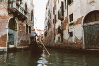Panoramic view of Venice narrow canal with historical buildings and gondolas