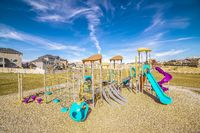 Brightly colored blue and purple play equipment