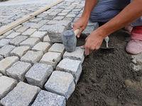 Worker Arranging a Pavement