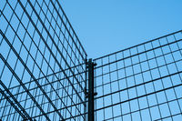 metal fence on blue sky -  metal grid construction