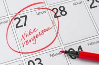 Save the Date written on a calendar - January 27 -  Nicht vergessen in german