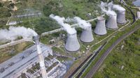 Smoking pipes of thermal power plant at summer