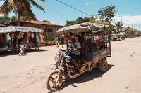 Malagasy family on vehicle, Madagascar