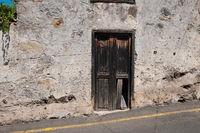 old wooden door on building ruin facade , abandoned house ,