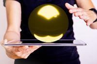 Woman balances with tablet pc a globe