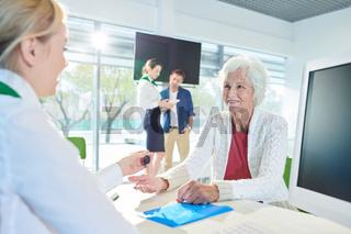 Senior lady buying flat with mortgage