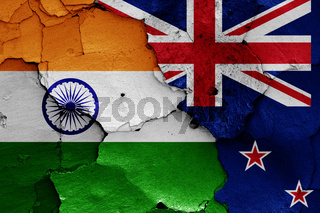 flags of India and New Zealand painted on cracked wall