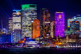 Sydney's city buildings illuminated with colours during Vivid Sydney