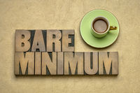bare minimum - word abstract in wood type