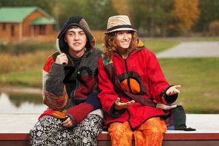 Happy young fashion hippie couple in love outdoor