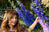 Florist  shop owner or customer outside with flower displays