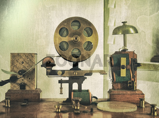vintage effect image of an old morse code telegraph machine with bell and brass printer