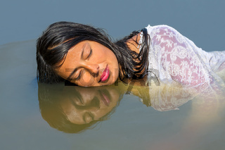 Portrait female face reflection in water