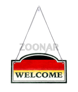 Germany welcomes you! Old metal sign isolated