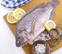Raw Whole Fish on a cutting board