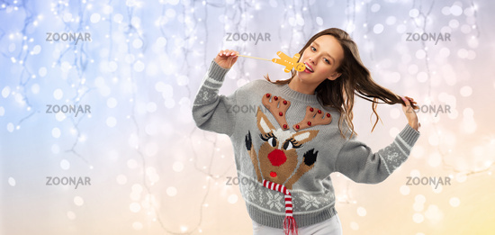 woman in christmas sweater with reindeer pattern