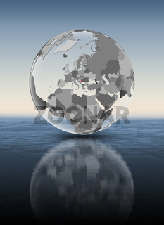 Serbia on translucent globe above water