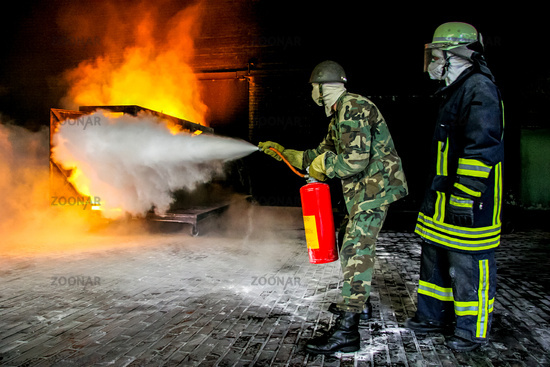 Firefighters training for fire fighting.