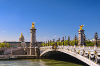 Paris France city skyline at Seine River with Pont Alexandre III bridge