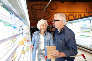 Senior Couple Choosing Milk