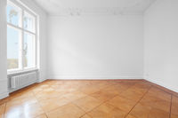 empty room with historic parquet floor newly renovated old building