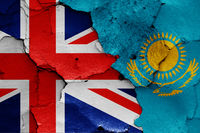 flags of UK and Kazakhstan painted on cracked wall