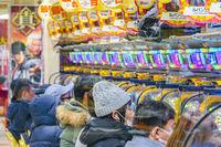 People Playing Pachinko, Tokyo, Japan