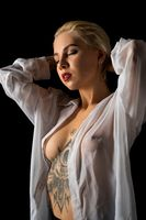 Tattooed blonde wearing unbuttoned shirt