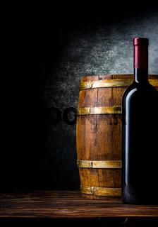 Bottle and barrel on black