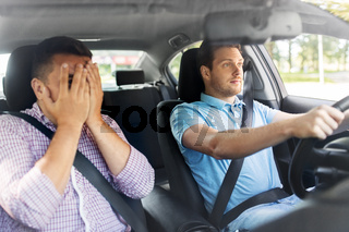 car driving school instructor and male driver